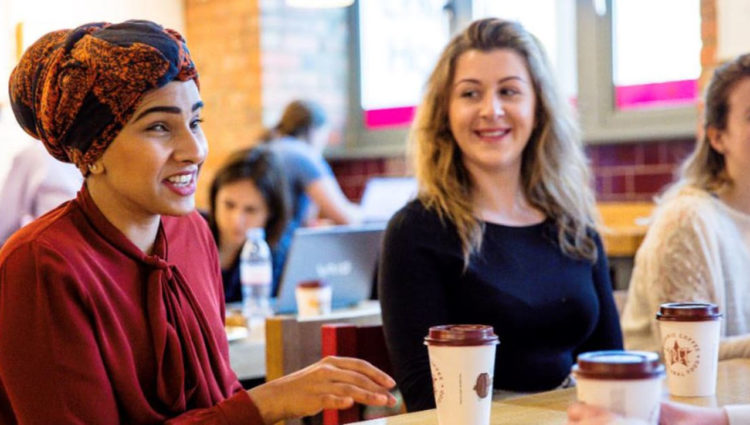 Image showing blind woman and sighted women conversing over coffee in a coffee shop