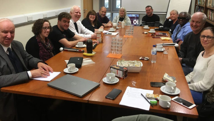 The sight loss council team round a large conference desk
