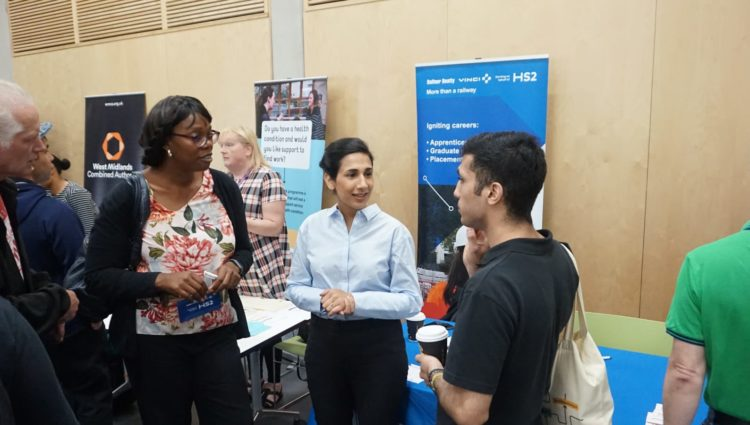 Image showing delegates talking at the Pan-Disability Jobs Fair