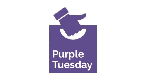 Purple Tuesday Logo - A hand doing a thumbs up holding a carrier bag that reads 'Purple Tuesday'