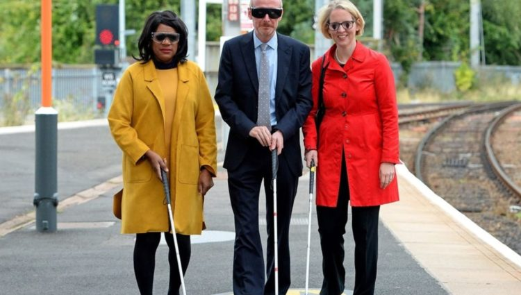 Image showing 3 people with walking sticks on the platform at Wolverhampton Train Station