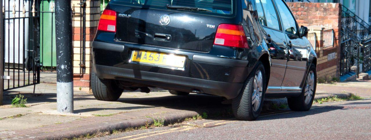 Black car parked on pavement