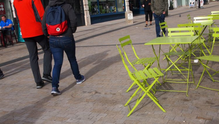High Street scene with cafe chairs placed right across the pavement