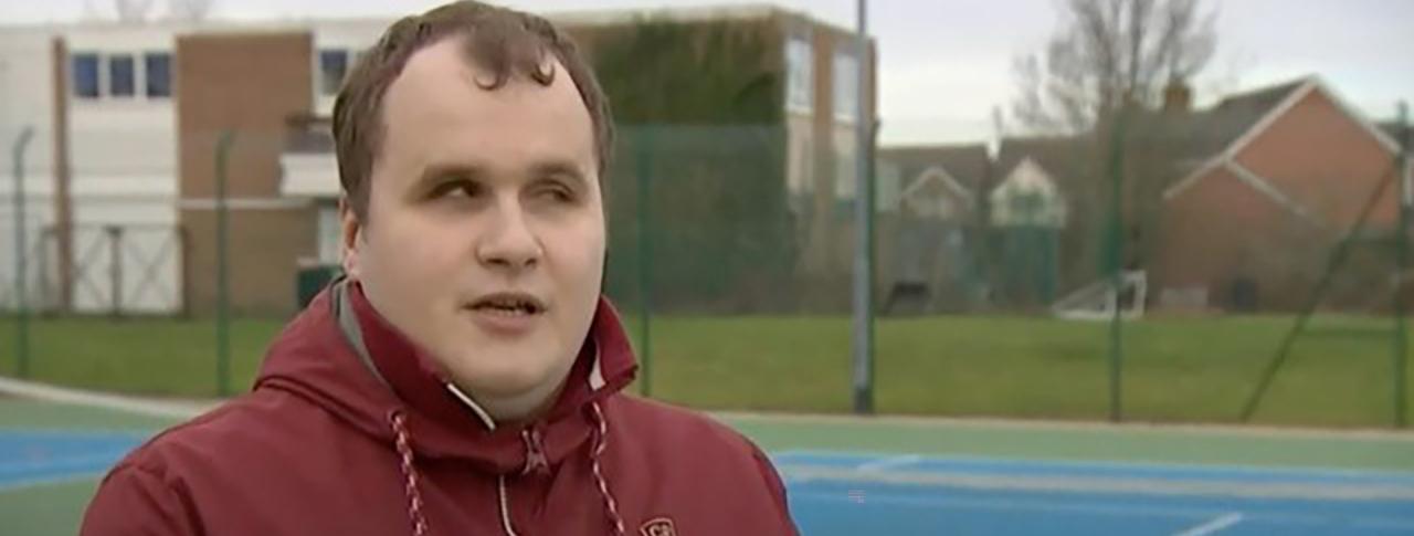 Hubert talking to BBC on a Tennis Court