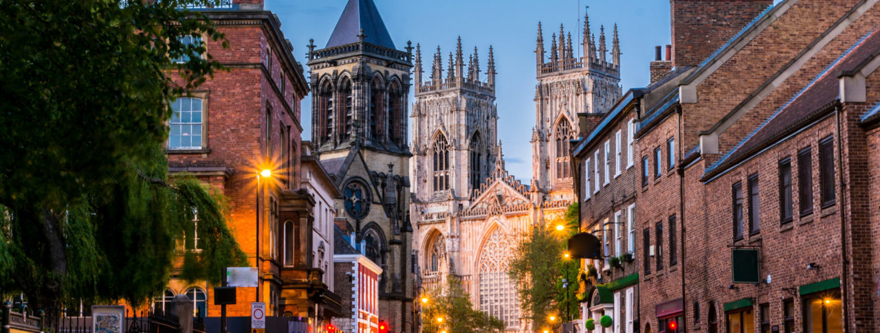 York Sight Loss Council image showing city streets at dusk with York Minster in the background