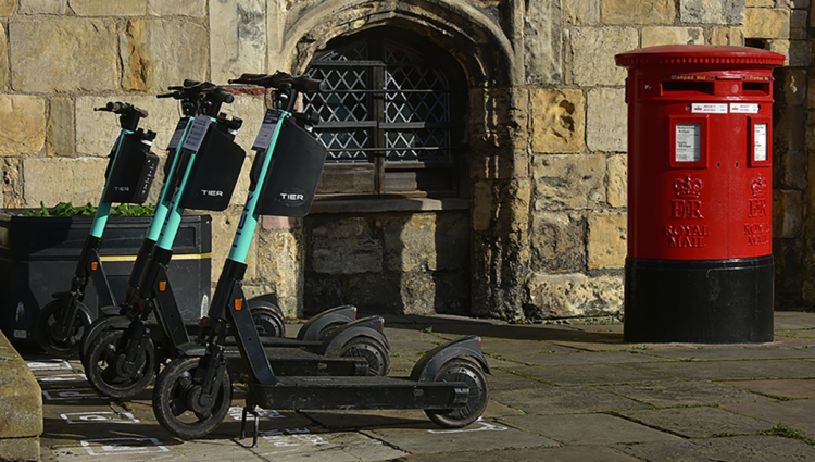 e-scooters parked on a street in York