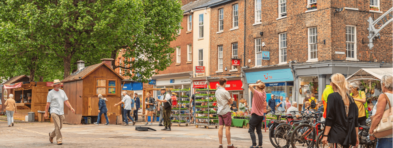 A busy pedestrianised road in York city centre