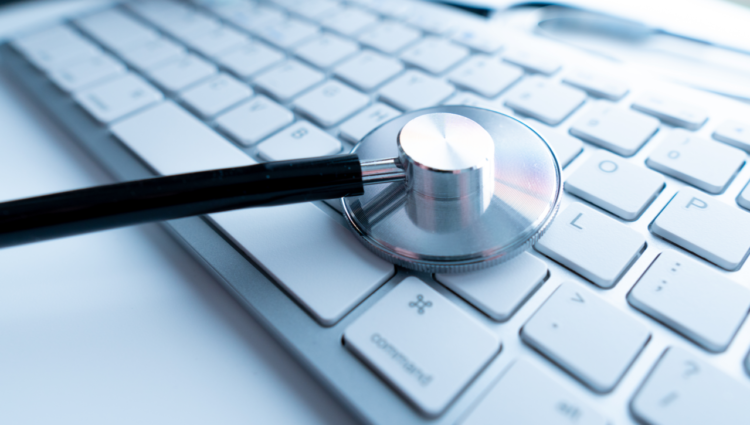 Macro view of a stethoscope on computer keyboard and key button with healthcare