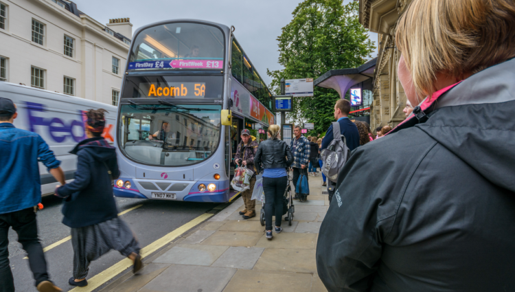 people getting on a bus in York