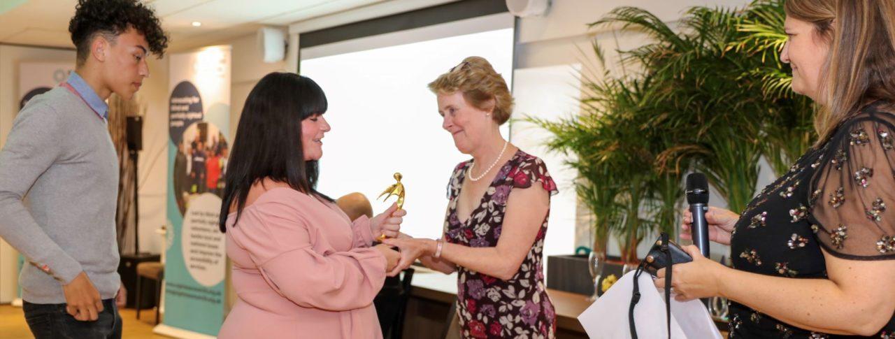 Outstanding Volunteer Award presented to Wayne Jordan's daughter Kerrie.